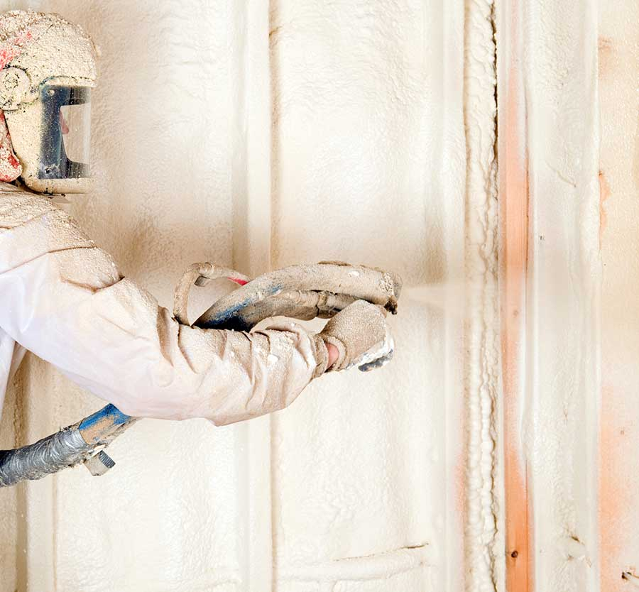 worker installing blow-in insulation | Atticare
